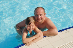 Little girl with the father in pool Royalty Free Stock Photography