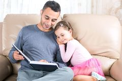 Little Girl And Father Reading Book Royalty Free Stock Photo