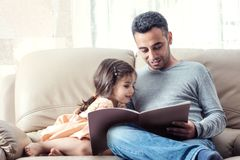 Little Girl And Father Reading Book Together Royalty Free Stock Photography