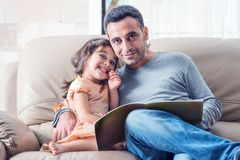 Little Girl And Father Reading Book Together Royalty Free Stock Image