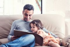 Little Girl And Father Reading Book Together Stock Photos
