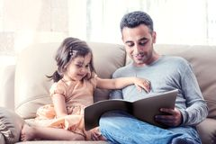 Little Girl And Father Reading Book Together Royalty Free Stock Photos