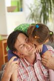 Little girl on father's shoulders Royalty Free Stock Image