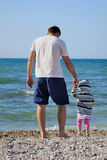 The little girl with the father on seacoast Stock Images