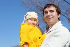 Little girl with father in spring park Stock Photo