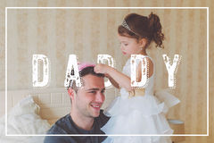 Little girl with father wearing crowns. Fathers day concept. Stock Photo