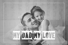 Little girl with father wearing crowns. Fathers day concept. Stock Images