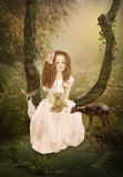 Little girl and Fawns stock images