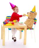 Little girl feeding Teddy bear Royalty Free Stock Image