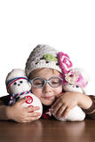 Little girl feels happy playing with her dolls Stock Photo