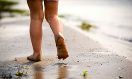 Little girl feet walk on beach Royalty Free Stock Photography