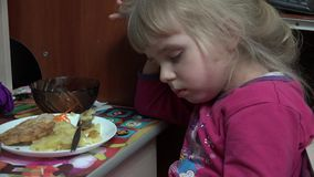 Little Girl Fell Asleep at the Table Eating Potato. 4k Ultra HD stock video footage