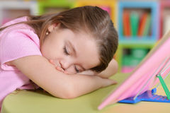 Little girl fell asleep at the table Royalty Free Stock Image