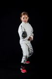 Little girl in fencing costume, attack position Royalty Free Stock Photo