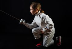 Little girl in fencing costume, attacking Royalty Free Stock Photography