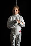 Little girl in fencing costume Stock Photos