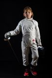 Little girl in fencing costume, relaxing position Stock Photography