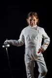 Little girl in fencing costume, relaxing position Royalty Free Stock Photography