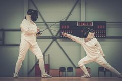 Little girl on a fencing training Stock Images