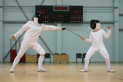 Little girl on fencing training Royalty Free Stock Images