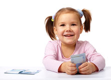 Little girl with few paper euro banknotes Stock Image