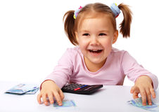 Little girl with few paper euro banknotes Stock Photos