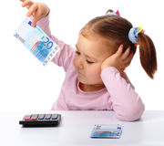 Little girl with few paper euro banknotes Stock Photography
