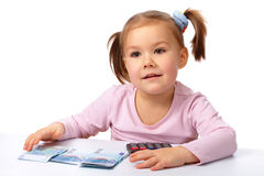 Little girl with few paper euro banknotes Royalty Free Stock Photography