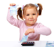Little girl with few paper euro banknotes royalty free stock image
