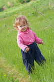 Little girl on the field Stock Image