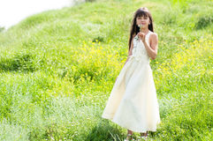 Little girl in field Royalty Free Stock Images