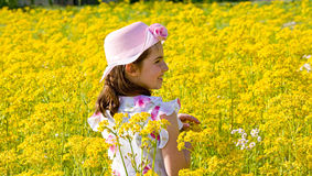 Little Girl in a Field. Of Goldenrods Royalty Free Stock Photos