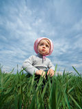 Little girl in field Stock Photo