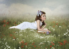Little girl in the field Stock Image