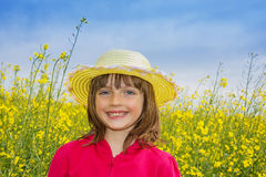 Little girl on a field with colza Stock Images