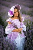 Little girl in a field of lavender. Little girl dressed as a princess in a field of lavender royalty free stock image