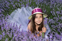 Little girl in a field of lavender. Little girl with a hat in a field of lavender royalty free stock images