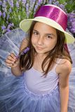 Little girl in a field of lavender. Little girl with a hat in a field of lavender stock images