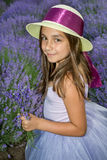Little girl in a field of lavender. Little girl with a hat in a field of lavender stock photos