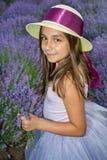 Little girl in a field of lavender. Little girl with a hat in a field of lavender Stock Photos