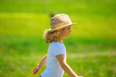 Little girl in field Stock Images
