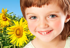 Little girl and field with sunflowers. Little girl four years old and field with sunflowers royalty free stock photos