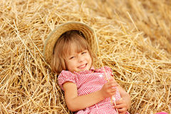 Little girl on the field with wheat Royalty Free Stock Photography