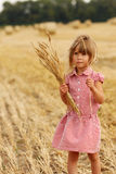 Little girl on the field with wheat Royalty Free Stock Photo