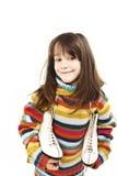Little girl with figure skates Stock Photos