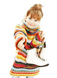 Little girl with figure skates, showing OK sign Royalty Free Stock Photography