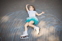 Little girl figure skating at imaginary skating rink arena Royalty Free Stock Photo