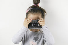 Little girl with a film camera royalty free stock photography