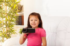 Little girl filming with camera Royalty Free Stock Photography