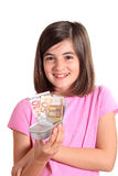 Little girl finding euro in a box Stock Photos